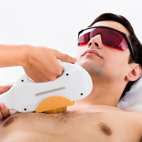 Man receiving laser hair treatment